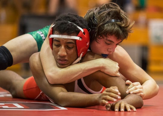 Fort Myers' Caleb Seneca defeated South Fort Myers' Jermaine Jackson Saturday afternoon, 01/11/21, during a district duals wrestling meet at SFMHS.