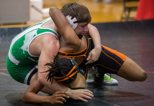Fort Myers' Riley Hackworth defeated Dunbar's Samuel Sinsimon in a 170lb match Saturday afternoon, 01/11/21, during a district duals wrestling meet at SFMHS.