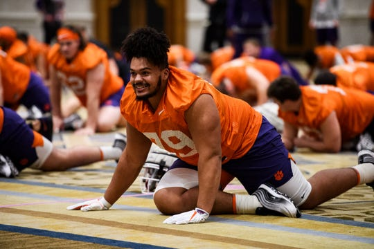 Clemson offensive lineman Jackson Carman (79) stretches during practice in the team hotel ballroom Saturday, Jan. 11, 2020.
