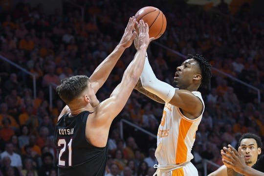 Tennessee guard Jordan Bowden (23) shoots the ball against South Carolina Gamecocks forward Maik Kotsar (21) during the first half at Thompson-Boling Arena Tuesday afternoon in Knoxville, Tenn.
