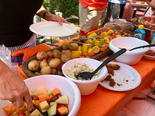 A Clemson tailgate gathering featuring Dennis Wilson's Lowcountry boil.
