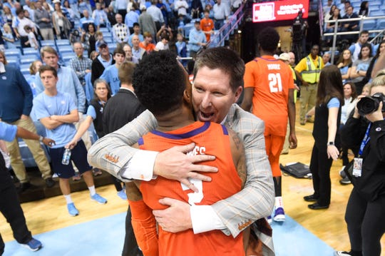Clemson Tigers head coach Brad Brownell hugs guard Al-Amir Dawes (2) after the game. The Clemson Tigers defeated the North Carolina Tar Heels in overtime at Dean E. Smith Center on Saturday.
