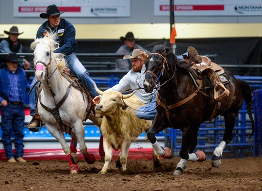 Ross Mosher competes in the steer wrestling event during the Montana Pro Rodeo Circuit Finals in the Four Seasons Arena, Friday, January 10, 2020.