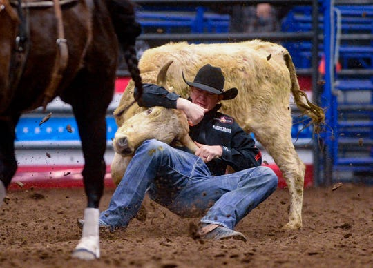 Ty Erickson records a 3.3 second run in the steer wrestling event during the Montana Pro Rodeo Circuit Finals in the Four Seasons Arena, Friday, January 10, 2020.