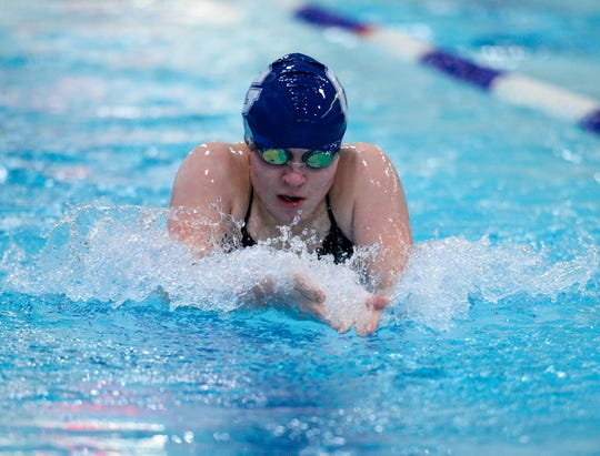 Great Falls High's Claire Earl swims the breast stroke in the 200 yard medley relay during Friday's swim meet against CMR, Helena High and Helena Capital.