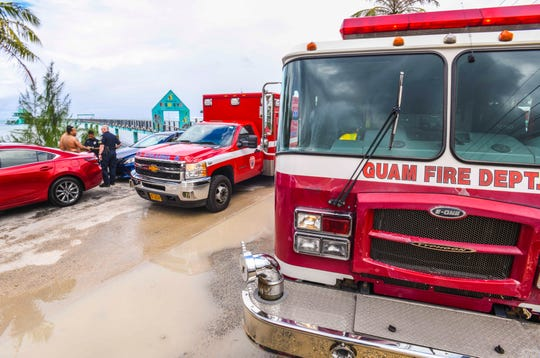 A Guam Fire Department ambulance prepares to depart the parking area of the Fish Eye Marine Park in Piti to transport a near-drowning victim to the hospital as other emergency responders gather information in regards to the incident on Saturday, Jan. 11, 2020.