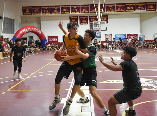 Father Duenas' Matthew Fegurgur posts up against the John F. Kennedy Islander during the 2020 GSPN Preseason Basketball Tournament championship game at the Father Duenas Memorial School Gym in Mangilao, Jan. 10, 2020. The Friars won the game 77-47.