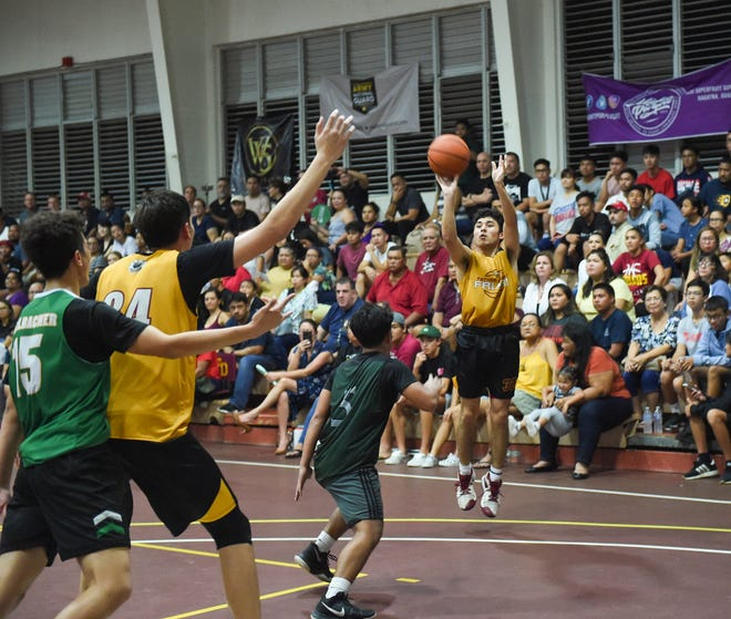 Father Duenas guard Isaiah Pelkey shoots against the John F. Kennedy Islanders during the 2020 GSPN Preseason Basketball Tournament championship game at the Father Duenas Memorial School Gym in Mangilao, Jan. 10, 2020. The Friars won the game 77-47.