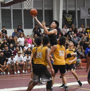 John F. Kennedy player Ralf Manalac drives to the bucket against the Father Duenas Friars during the 2020 GSPN Preseason Basketball Tournament championship game at the Father Duenas Memorial School Gym in Mangilao, Jan. 10, 2020. The Friars won the game 77-47. High school basketball kicks off this week in two separate leagues, although there are plays to have interlague play on Saturdays during the third quarter season.