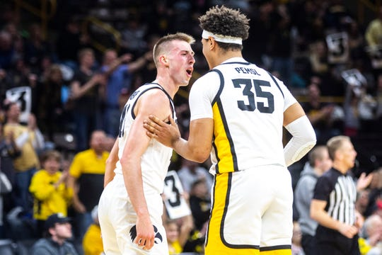 Iowa guard Joe Wieskamp, left, celebrates with teammate Cordell Pemsl after making a 3-point basket during a NCAA college Big Ten Conference men's basketball game, Friday, Jan. 10, 2020, at Carver-Hawkeye Arena in Iowa City, Iowa.