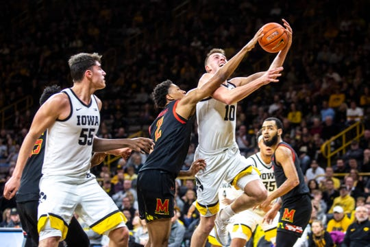 Iowa guard Joe Wieskamp (10) drives to the basket as Maryland's Aaron Wiggins (2) defends during a NCAA college Big Ten Conference men's basketball game, Friday, Jan. 10, 2020, at Carver-Hawkeye Arena in Iowa City, Iowa.