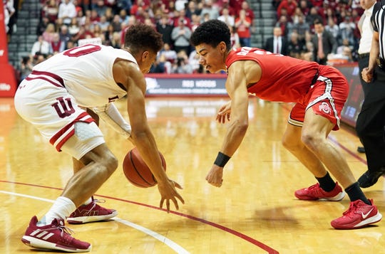 Indiana Hoosiers guard Rob Phinisee (10) steals the ball from Ohio State Buckeyes guard D.J. Carton (3) during the game against Ohio State at Simon Skjodt Assembly Hall in Bloomington, Ind., on Saturday, Jan. 11, 2020.