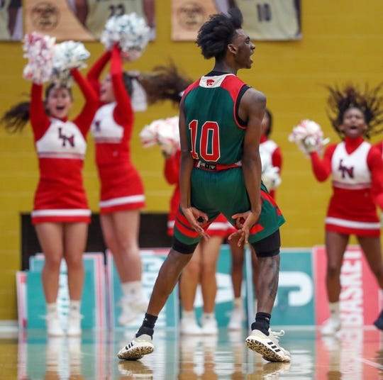 Lawrence North Wildcats Shamar Avance (10) celebrates a made three-point shot late in the game against the Warren Central Warriors at Warren Central High School on Friday.