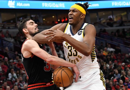 Jan 10, 2020; Chicago, Illinois, USA; Indiana Pacers center Myles Turner (33) and Chicago Bulls guard Tomas Satoransky (31) go for a loose ball during the second half at United Center. Mandatory Credit: David Banks-USA TODAY Sports