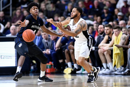 Jan 10, 2020; Providence, Rhode Island, USA;  Providence Friars guard Luwane Pipkins (12) passes the ball in front of Butler Bulldogs guard Khalif Battle (4) during the first half at the Dunkin Donuts Center. Mandatory Credit: Brian Fluharty-USA TODAY Sports