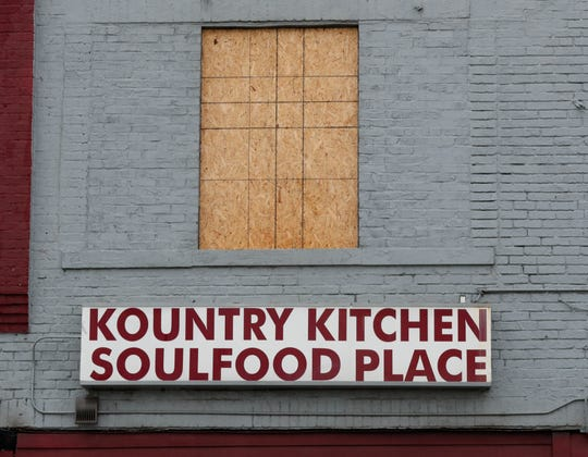 Windows and doors are boarded up after an early morning fire at the historic Kountry Kitchen Soulfood Place, 1831 N. College Ave., in Indianapolis Ind., Saturday, Jan. 11, 2020.