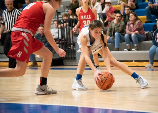 Karns' Anna Kate Reichter (13) retrieves the ball during the Karns and Halls basketball game on Friday, Jan. 10, 2020 at Karns High School.