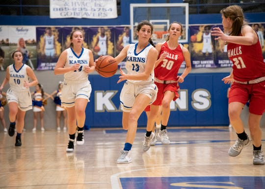 Karns' Anna Kate Reichter (13) dribbles the ball during the Karns and Halls basketball game on Friday, Jan. 10, 2020 at Karns High School.