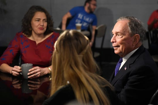 Democratic presidential candidate Mike Bloomberg speaks with Knoxville Mayor Indya Kincannon and her daughters at Perk City, in East Knoxville, Friday, Jan. 10, 2020.