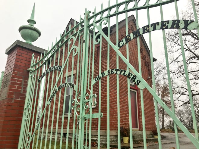 """The gates leading into Greenbush Cemetery read, """"Here rest our old settlers."""" Fairfield Township, which took on maintenance of the cemetery after the association that ran it ran out of money, has applied for a local historic district designation for grounds established in 1848."""
