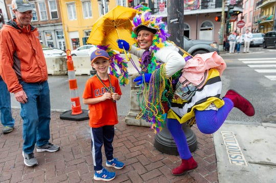 Jennifer Jones, The Dancing Lady of New Orleans handing out beads to 7 yr old Clemson  fan Wilson Brasington during pre game activities for the 2020 College Football Playoff National Championship, Saturday, Jan. 11, 2020.