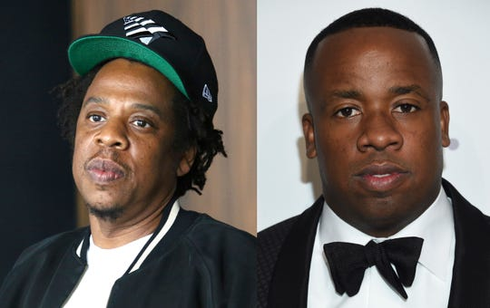 Rap mogul Jay-Z, left, and hip-hop artist Yo Gotti