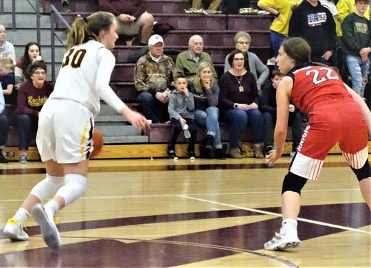 Berne Union's Bella Kline brings the ball up the court against Fairfield Union's Kennedy Couch during Friday's Mid-State League-Cardinal Division game. The Rockets won, 46-35.