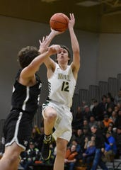 Howell's Tony Honkala (12) scored 21 points in a 59-54 victory over Plymouth on Friday, Jan. 10, 2020.