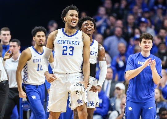 Kentucky's EJ Montgomery smiles as he greets teammate Nick Sestina during a timeout in the game against Alabama. Jan. 11, 2020
