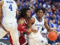 Kentucky's Tyrese Maxey uses a screen by Nick Richard to drive during the game against Alabama. Jan. 11, 2020