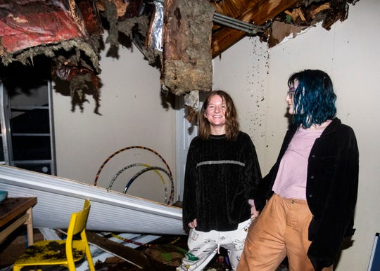 Vivian Cheslack (left) and Anna Warm (right) stand inside their flooded tree-damaged living room at East Parkway Apartment building in Memphis, Tenn., on Jan. 11, 2020.