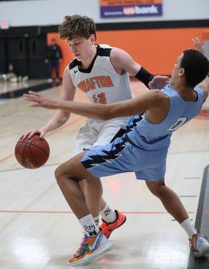 Grafton's Brock Heffner and Nicolet's Kobe Johnson make contact near the basket.