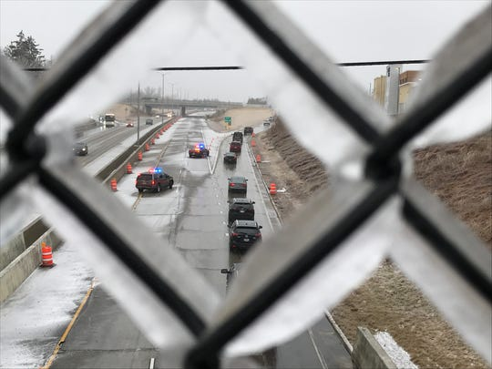 Milwaukee County Sheriff's deputies direct motorists off Interstate 43 northbound at Good Hope Road. I-43 northbound was closed because a semi rolled over due to icy conditions.