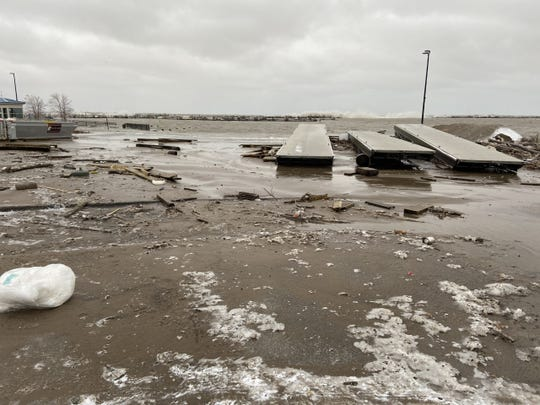 Docks and pier debris near South Shore Yacht Club wash up at South Shore Park in Milwaukee on Saturday. Wind-whipped waves badly damaged the marina.