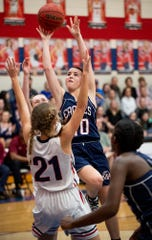 Montgomery Academy's Madi Caddell (10) shoots over Trinity's Kaylee Peevy (21) on the Trinity campus in Montgomery, Ala., on Friday January 10, 2020.