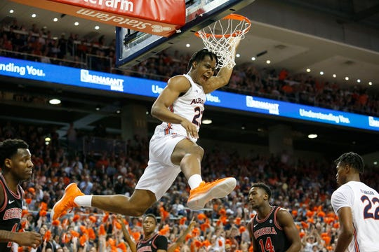 Auburn forward Isaac Okoro (23) reacts after a dunk  against Georgia at at Auburn Arena on Jan. 11, 2020.