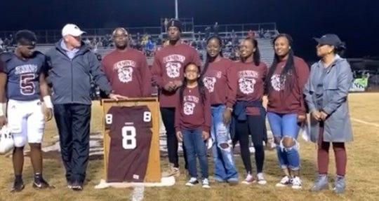 Jennings High School retires Travis Etienne's football jersey.