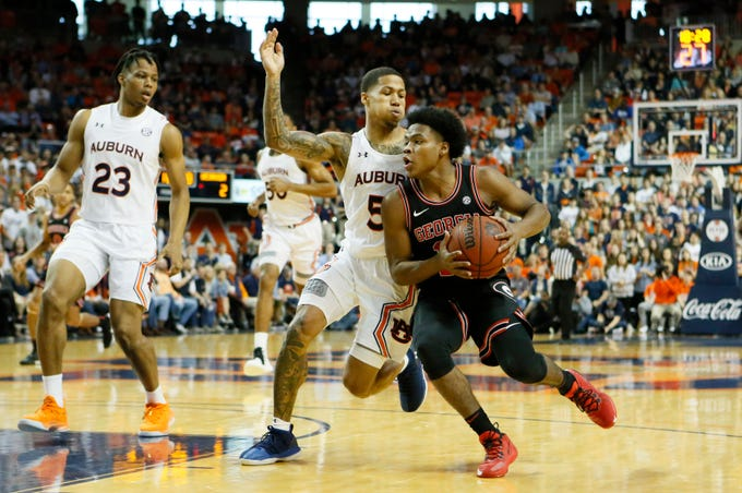 Jan 11, 2020; Auburn, Alabama, USA;  Auburn Tigers guard J'Von McCormick (5) pressures Georgia Bulldogs guard Sahvir Wheeler (15) during the first half at Auburn Arena. Mandatory Credit: John Reed-USA TODAY Sports