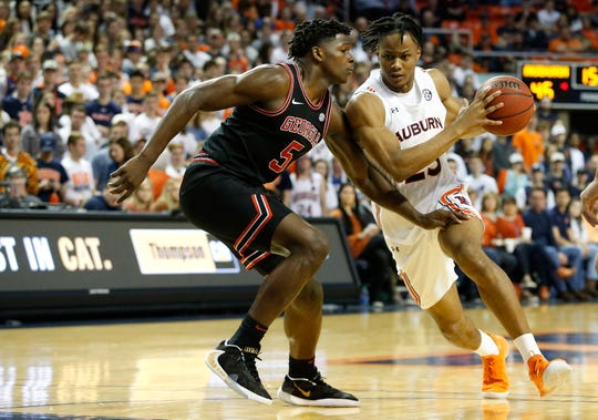 Auburn forward Isaac Okoro (23) drives against Georgia guard Anthony Edwards (5) during a game at Auburn Arena on Jan. 11, 2020.