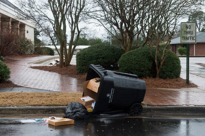 A trash can is knocked over on Narrow Lane Parkway in Montgomery, Ala., on Saturday, Jan. 11, 2020.