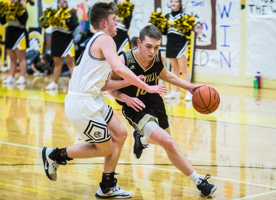 FILE -- Daleville's Tim Arnold drives past a Cowan defender during their game at Cowan High School Friday, Jan. 10, 2020.