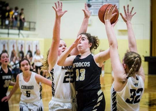 Daleville's Malia Walker shoots past Cowan's defense during their game at Cowan High School Friday, Jan. 10, 2020.
