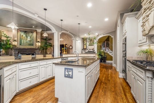 The kitchen is open to the great room and has an island and a large eat-at bar.
