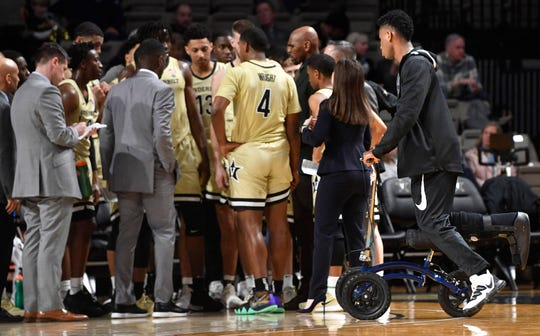 Vanderbilt forward Aaron Nesmith (24) wheels over to join the team during a break after he was injured recently at Memorial Gym in Nashville, Tenn. Saturday, Jan. 11, 2020.