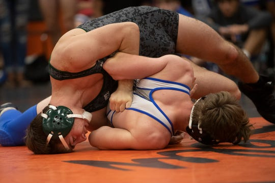 Barron Collier's Curtis Poulson takes on Palmetto Ridge's Landon Taylor in the 152-pound weight class during a wrestling tournament, Saturday, Jan. 11, 2020, at Lely High School. Taylor beat Poulson 10-7 in the final match to help Barron Collier to defeat Palmetto Ridge 35-33.