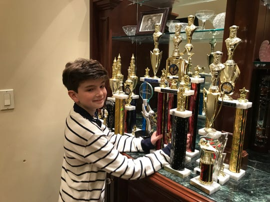 Gary Leschinsky with his chess trophies