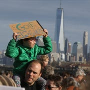 Hannah Bradshaw 6 of Jersey City with her father Tim as the came to support the Liberty State Park Protection Act and protest any proposed amendment allowing for the privatization of LSPÕs Caven Point Natural Area. There is a proposal to expand the golf course by three holes.
