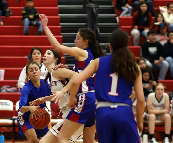 Deming High leans heavy on junior Sierra Manos  (with ball) for rebounding. On Friday night, the Lady 'Cat forward tossed in a game-high 17 points to lead her teammates to a 54-42 District 3-5A victory over the Las Cruces High Bulldawgs.