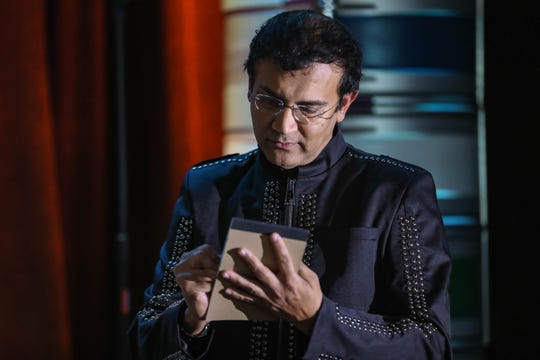 Imran Raza, pictured in Raze Studio Illusions and Magic in Las Cruces on Friday, Jan. 10, 2019, is predicting the headlines of the Jan. 18 Las Cruces Sun-News, which will part of his act in a Jan. 18 show.