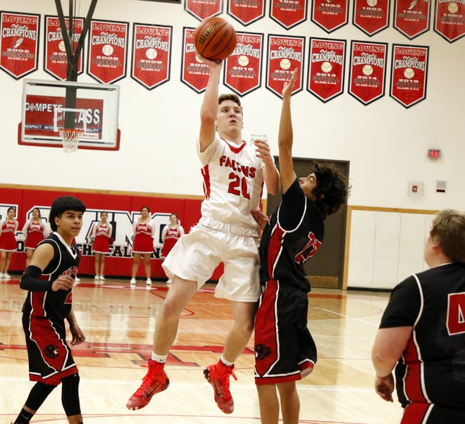 Loving's Dylan Green takes a contested shot against Lake Arthur on Jan. 10, 2020. Green scored 18 points and Loving won, 75-38.